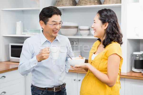 Happy expectant couple in the kitchen Stock photo © wavebreak_media
