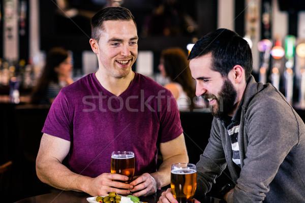 Friends having a pint Stock photo © wavebreak_media
