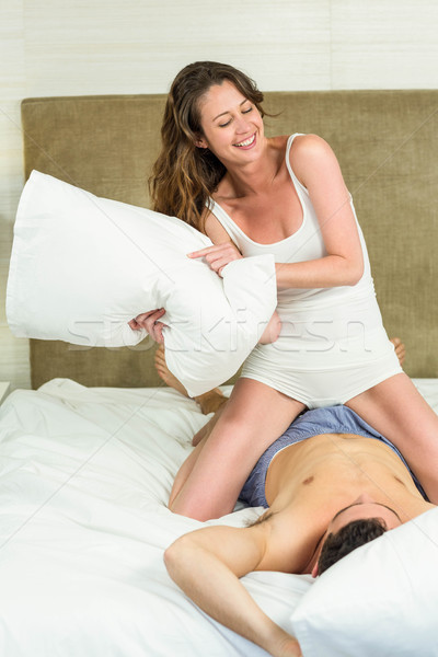 8524021_stock-photo-woman-playing-pillow
