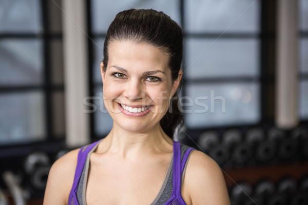 Smiling pregnant woman looking at the camera Stock photo © wavebreak_media