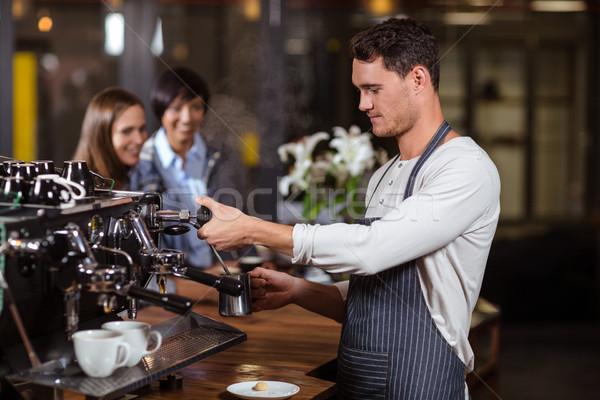 Barista making hot milk with coffee machine Stock photo © wavebreak_media