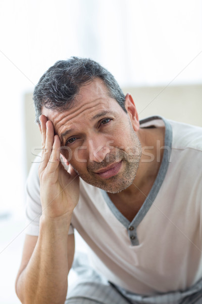 Worried man sitting on bed Stock photo © wavebreak_media