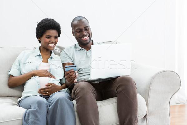 Hamile çift alışveriş çevrimiçi dizüstü bilgisayar ev Stok fotoğraf © wavebreak_media