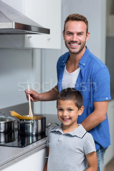 Young man cooking spaghetti Stock photo © wavebreak_media
