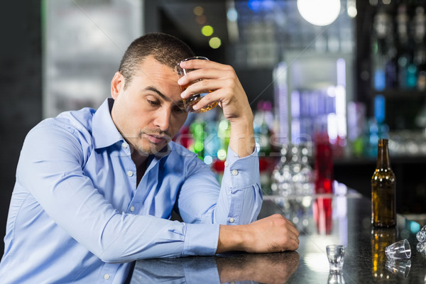 Depressed man having a whiskey Stock photo © wavebreak_media