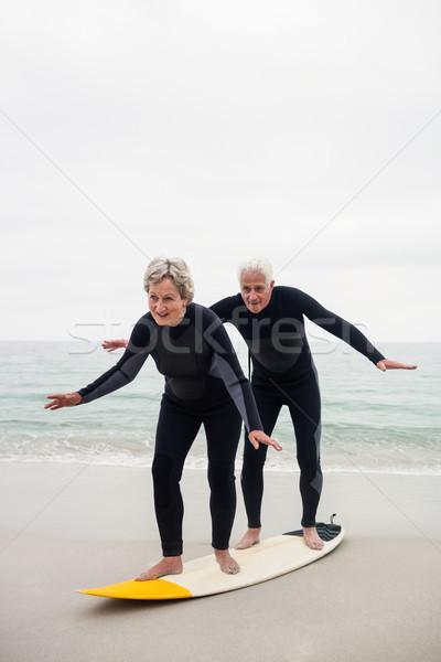 Idős pár szörfözik tengerpart boldog szörfdeszka napos idő Stock fotó © wavebreak_media