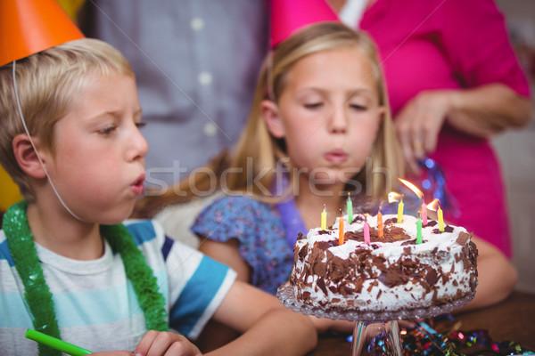 Siblings blowing birthday candles  Stock photo © wavebreak_media