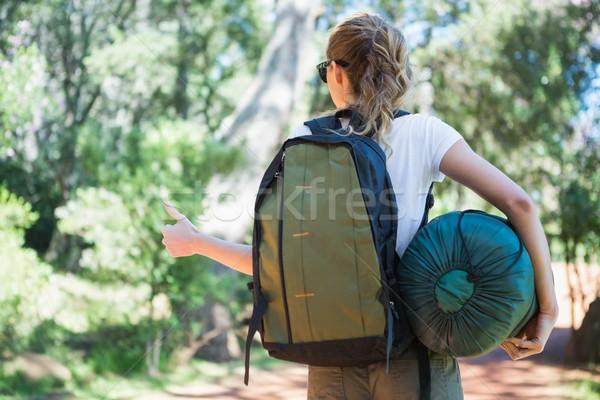 Hitch hiking woman with sleeping bag Stock photo © wavebreak_media