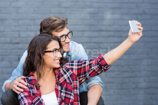 Young couple in spectacles taking a selfie Stock photo © wavebreak_media