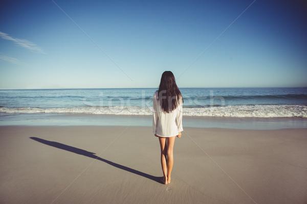 Woman standing on beach Stock photo © wavebreak_media