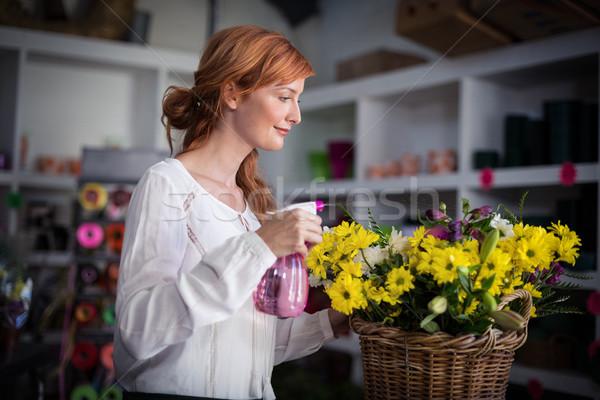 Feminino florista água flores compras Foto stock © wavebreak_media