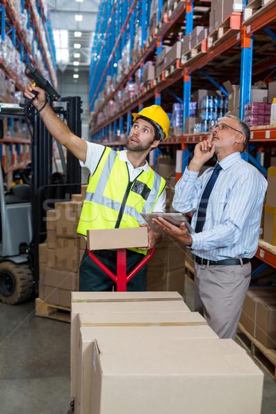Imprenditore magazzino lavoratore business uomo sorridere Foto d'archivio © wavebreak_media