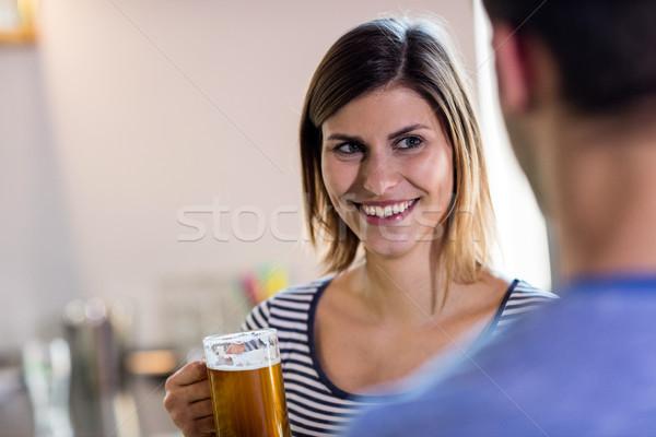 Kadın bakıyor erkek arkadaş içme bira mutlu Stok fotoğraf © wavebreak_media