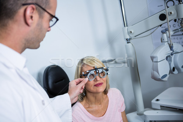 Optometrist examining female patient with messbrille Stock photo © wavebreak_media