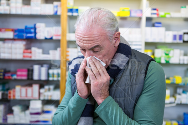 Customer covering his nose with handkerchief while sneezing Stock photo © wavebreak_media