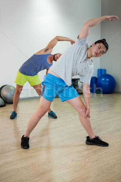 Two men doing aerobic exercise Stock photo © wavebreak_media