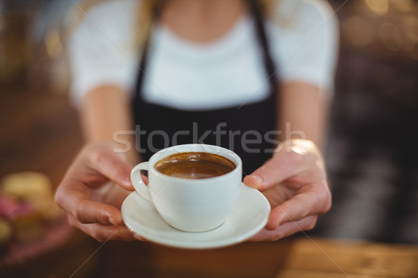 Waitress offering a cup of coffee Stock photo © wavebreak_media