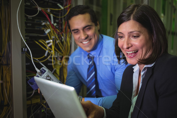 Technicians using digital tablet while analyzing server Stock photo © wavebreak_media