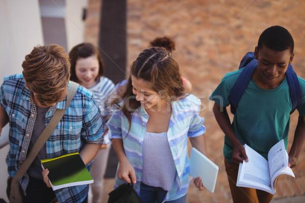 élèves livres numérique comprimé marche Photo stock © wavebreak_media