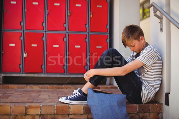 Sad schoolboy sitting on staircase Stock photo © wavebreak_media