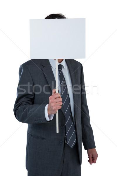 Imprenditore faccia dietro bianco comunicazione Foto d'archivio © wavebreak_media
