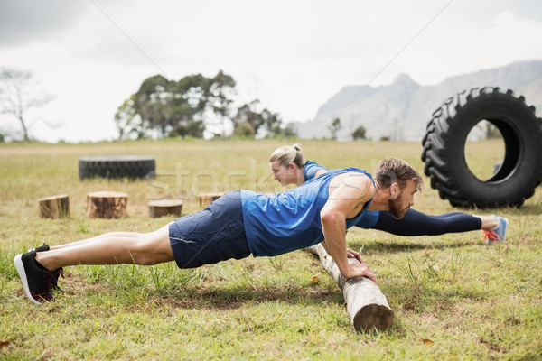 Fit people performing pushup exercise Stock photo © wavebreak_media