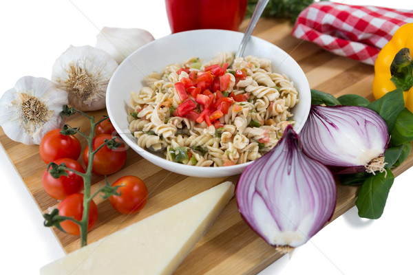 Pasta served in bowl amidst vegetables on cutting board Stock photo © wavebreak_media