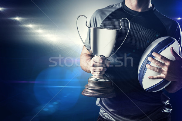 Composite image of midsection of successful rugby player holding Stock photo © wavebreak_media