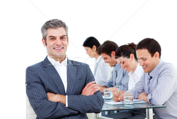 Mature manager and his team writting notes in a meeting Stock photo © wavebreak_media