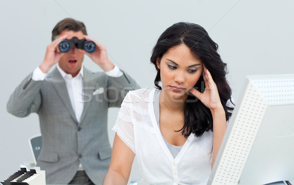 Young businesswoman getting bored and her manager looking throug Stock photo © wavebreak_media