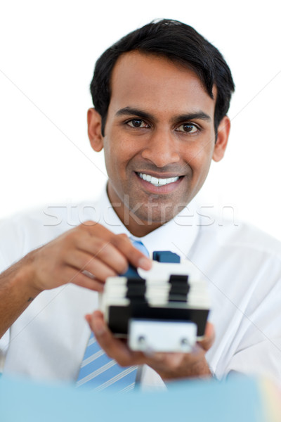 Smiling businessman searching for the index  Stock photo © wavebreak_media