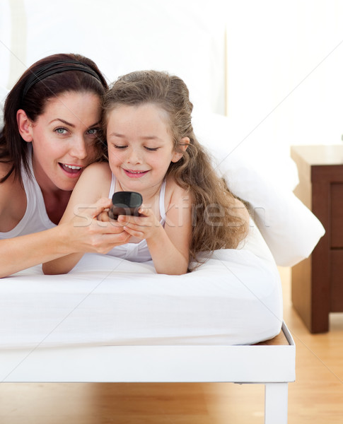 Attractive mother and her daughter having fun  Stock photo © wavebreak_media