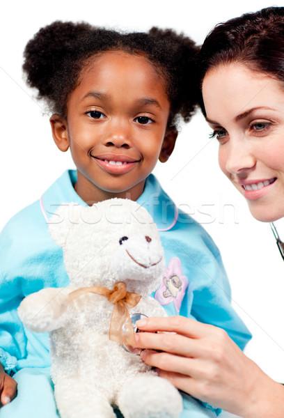 Aandachtig arts spelen patiënt witte medische Stockfoto © wavebreak_media