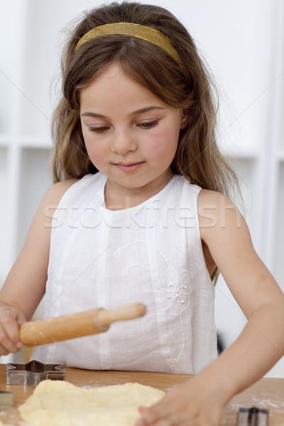 Little girl baking in the kitchen Stock photo © wavebreak_media