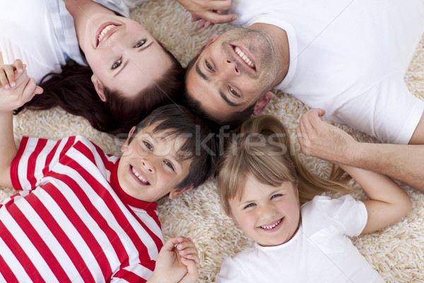 Stock photo: High angle of family on floor with heads together