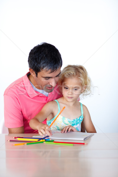 Radiant father drawing with his daughter Stock photo © wavebreak_media
