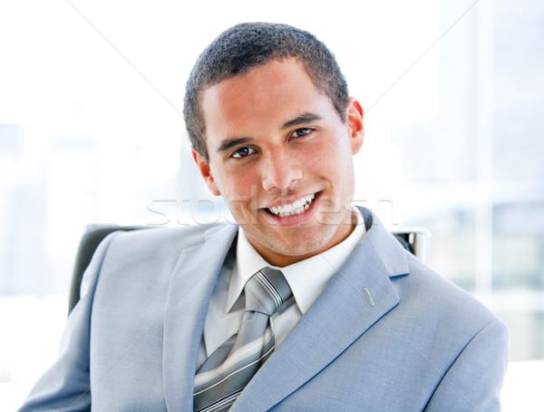 Séduisant jeunes affaires séance bureau souriant Photo stock © wavebreak_media