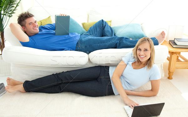 Encantador casal tempo livre juntos sala de estar mulher Foto stock © wavebreak_media