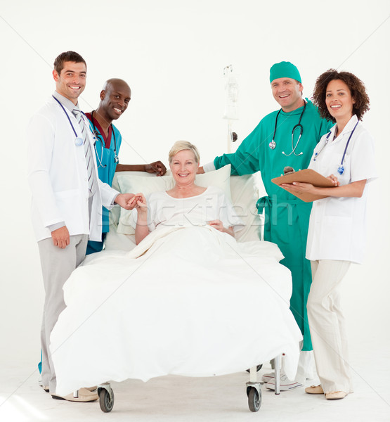Group of doctors attending to a patient in a hospital  Stock photo © wavebreak_media