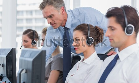 Delighted manager leading her representative team in a office Stock photo © wavebreak_media