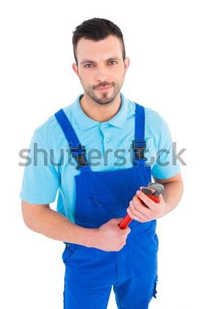 Charyzmatyczny mechanik narzędzie uśmiechnięty kamery Zdjęcia stock © wavebreak_media
