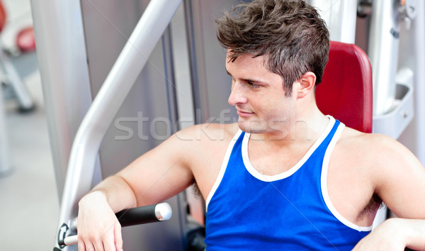 молодым человеком скамейке прессы фитнес центр Сток-фото © wavebreak_media