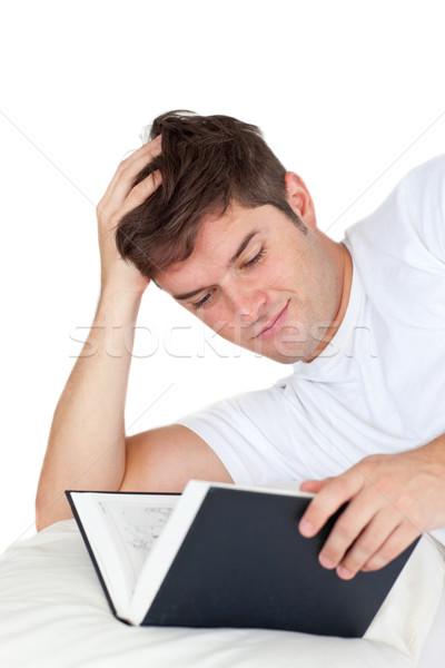 魅力的な 男 読む 図書 ベッド 白 ストックフォト © wavebreak_media