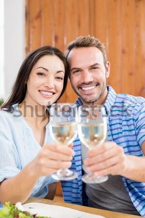 пару питьевой шампанского диван Смотря телевизор Сток-фото © wavebreak_media