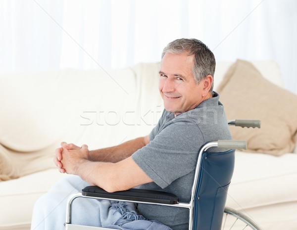 Homem maduro cadeira de rodas olhando câmera casa médico Foto stock © wavebreak_media