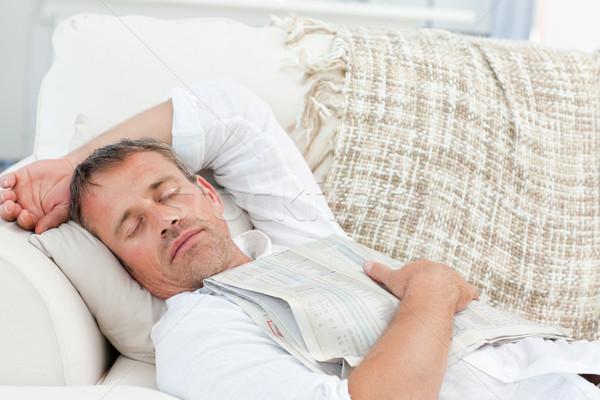 Sfinito uomo dormire divano home casa Foto d'archivio © wavebreak_media