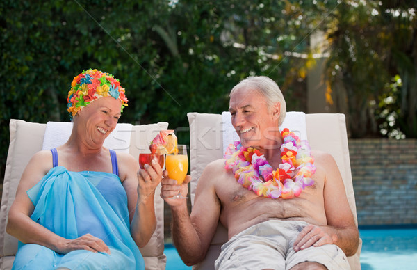 Happy senior couple drinking cocktails and toasting each other  Stock photo © wavebreak_media