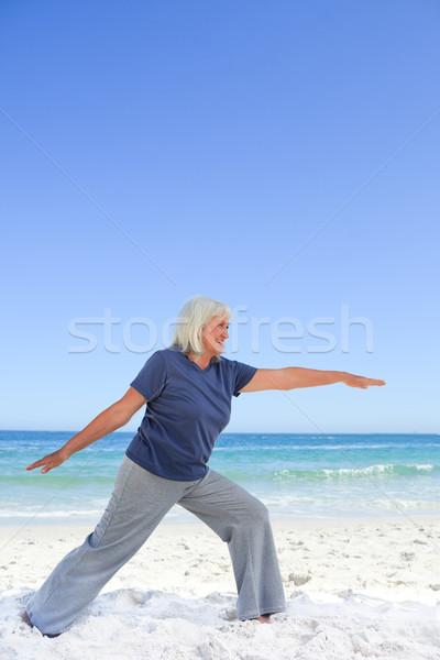 Emekli kadın plaj su eller deniz Stok fotoğraf © wavebreak_media