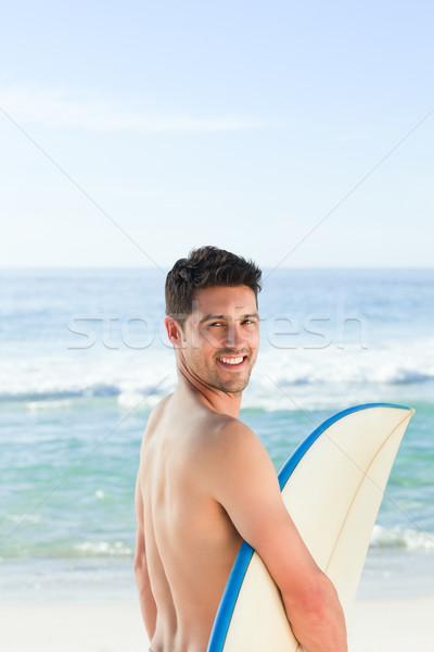 Bell'uomo accanto mare tavola da surf acqua sport Foto d'archivio © wavebreak_media