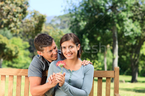Man and his wife with a flower Stock photo © wavebreak_media